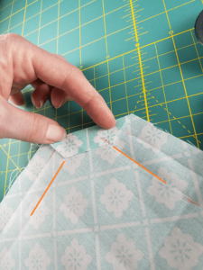 Corner folded to meet lines. Busy Creative Napkin DIY