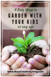 Child holding seedling. Gardening with Kids