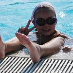 Child having fun in pool on staycation