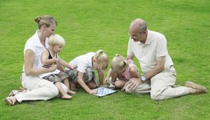 Family playing board games. Staycation ideas for families