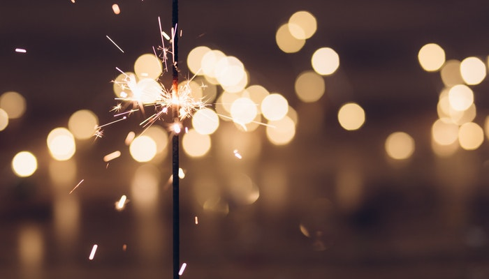 Sparkler with fireworks.