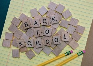 Back to school spelled in game tiles. Budget for back to school now.