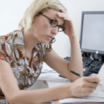 Stressed woman staring at budget