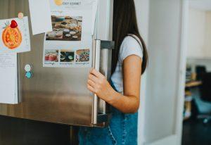 Person looking in refrigerator