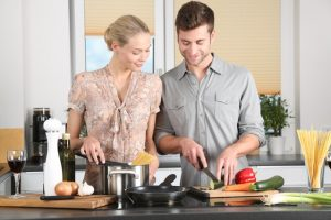Man and woman cooking. Date night ideas for any budget.