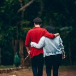 Man and woman walking dog. Affordable date ideas
