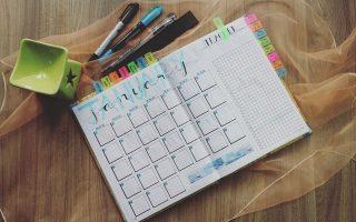 Photo of planner and pens. Tracking irregular bills
