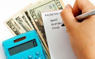 Cash, calculator and written budget.