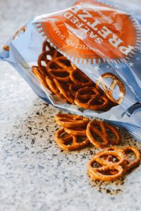 Open bag of pretzels. Stashing snacks helps avoid buying weekday lunch & saves money.