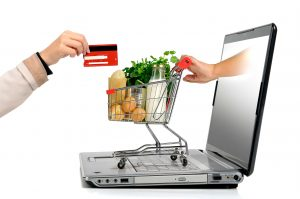 Handing credit card through computer for grocery basket