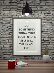 Sign on wall with light. Do something today that your future self will thank you for.